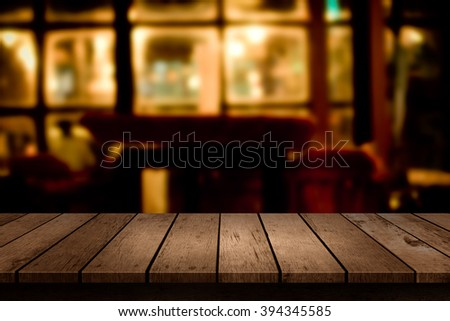 wooden table with a view of blurred restaurant backdrop - stock photo