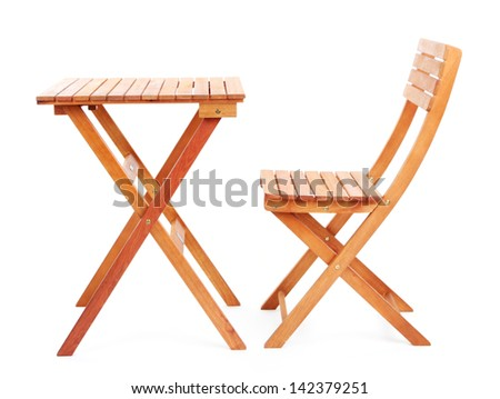Wooden table with chair isolated on white