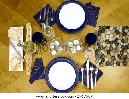 Wooden table with everything ready for occasional dinner for two person (top view) - stock photo
