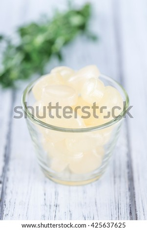 Wooden table with Menthol Candies (selective focus; close-up shot) - stock photo
