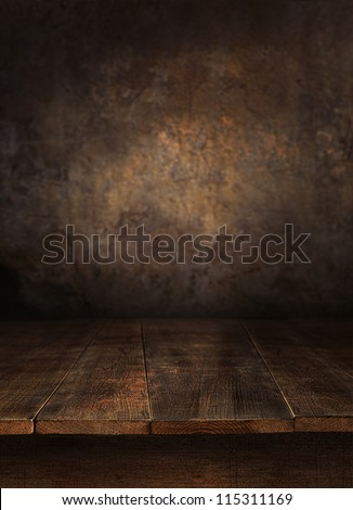 Wooden table with old wall background - stock photo