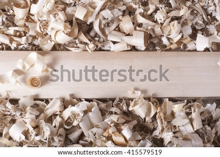 Wooden table with sawdust. Carpenter workplace top view - stock photo