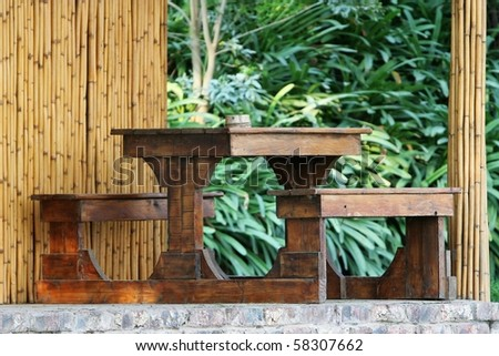 Wooden table with seats outside holiday house - stock photo
