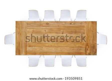 Wooden Table with Ten Chairs Around  - stock photo