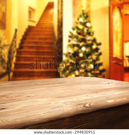 wooden table xmas tree and interior of home  - stock photo