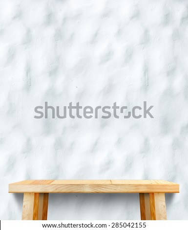 wooden tabletop at ripple concrete wall,Template mock up for display of product,Business presentation. - stock photo