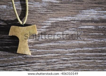wooden Tau pendant - stock photo