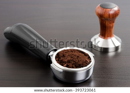Wooden temper and coffee, close-up - stock photo