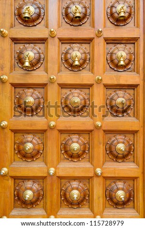 Wooden Temple Door With Bells In Hindu Temple