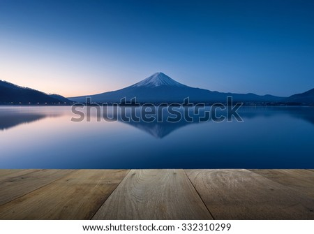 wooden terrace and mountain fuji with reflection at lake kawaguchiko in the morning - stock photo