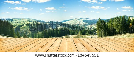 wooden terrace and panorama of early spring in the mountains. Carpathian, Ukraine, Europe - stock photo