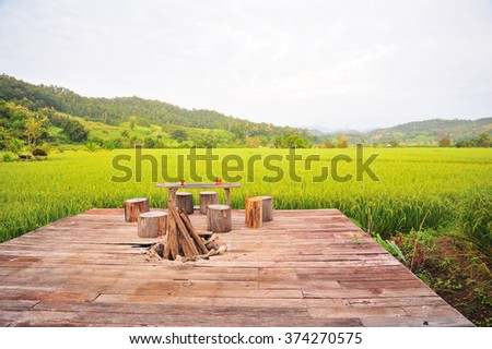 Wooden Terrace in The Rice Field - stock photo