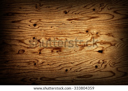 Wooden texture of a dark wide plank - stock photo