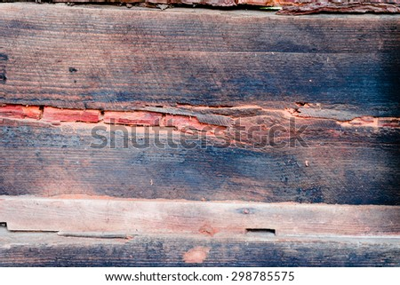 Wooden texture of brown color with scratches and cracks, which can be used as a background