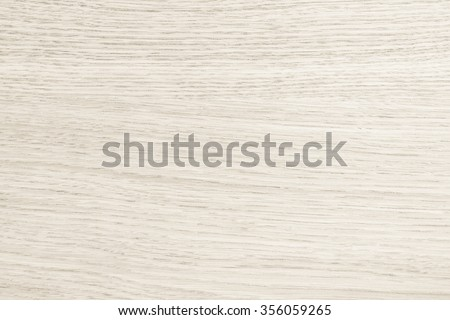 Wooden textured grainy detail backdrop in natural light sepia tan cream beige brown color tone: Birch wood laminated closeup detailed texture pattern background in creme beige earth toned colour