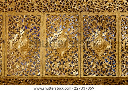 Wooden Thai style carving art at the temple - stock photo