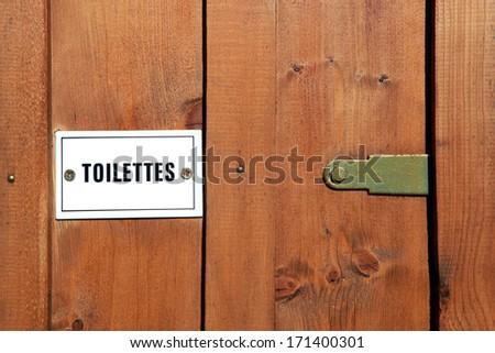Wooden toilet door - stock photo