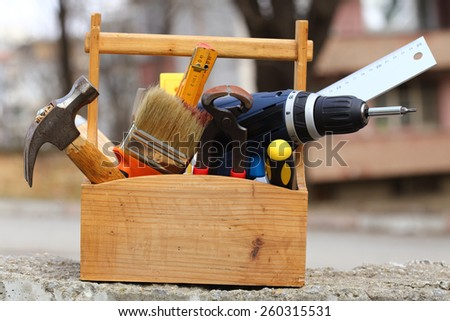 wooden tool box at work close up - stock photo
