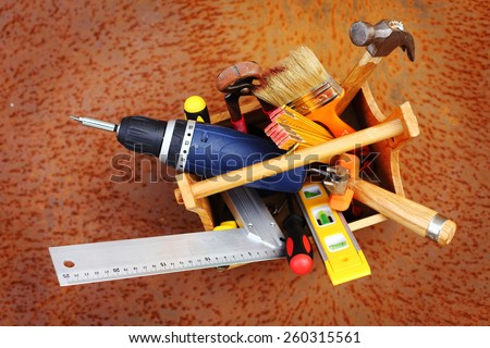 wooden tool box at work on a rusty background - stock photo