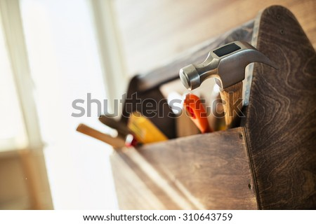 Wooden toolbox on the table - stock photo