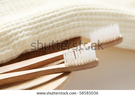 wooden toothbrush and towel,Closeup. - stock photo