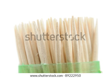 Wooden Toothpicks in Plastic Case on White Background