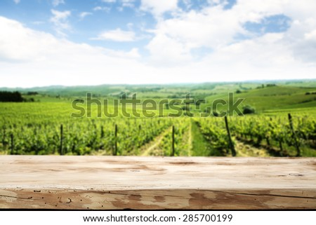 wooden top and green landscape and sky  - stock photo