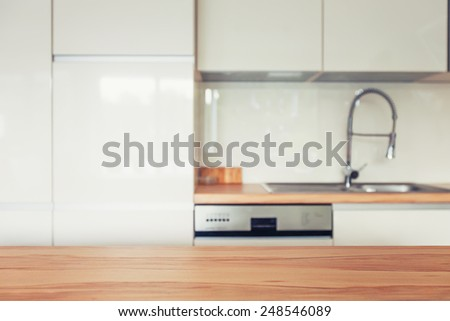 Wooden top and modern kitchen space - stock photo