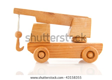 Wooden tow truck with crane isolated over white - stock photo