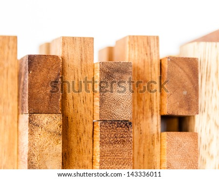 Wooden toy blocks isolated on white background