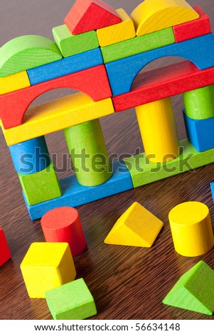 wooden toy blocks on wooden table - stock photo