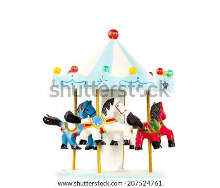Wooden toy carousel - stock photo