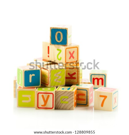 wooden toy cubes with letters. Wooden alphabet blocks. - stock photo