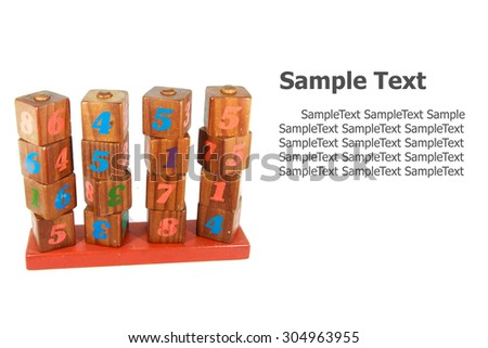 wooden toy cubes with letters. Wooden numeric blocks. isolated on white background - stock photo
