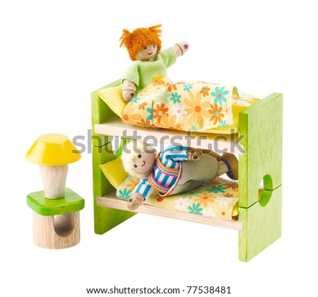Wooden toy dolls in the bedroom an image isolated on white - stock photo