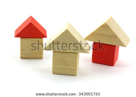 wooden toy home isolated in studio - stock photo