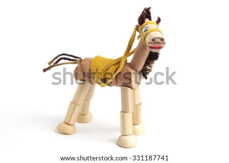 Wooden toy horse with articulated parts on white background.
