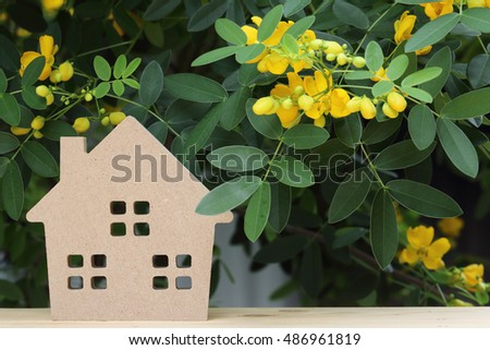 wooden toy house with beautiful blossom tree