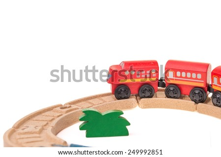 Wooden Toy Red train rail set with green glass on White Isolated Background - stock photo