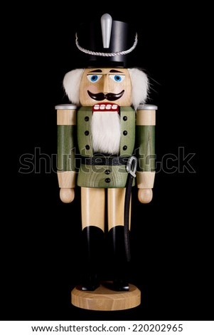 wooden toy soldier nutcracker isolated on black background  - stock photo