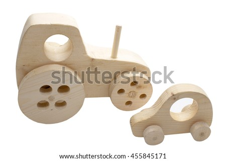 wooden toy tractor and a car. wooden toy transportation vehicles. isolated on white background - stock photo