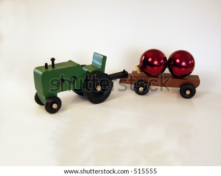 wooden toy tractor w/ Christmas bulbs - stock photo