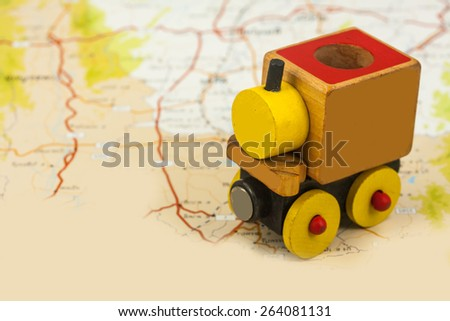 wooden toy train on map , abstract background for solution of transportation or traveling concept. - stock photo
