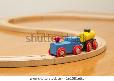 wooden toy train set on tracks - stock photo