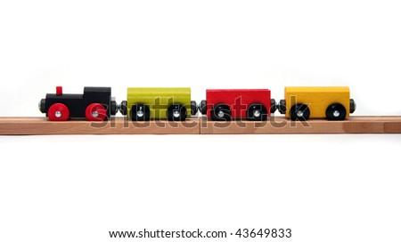 Wooden Toy Train Set on White Background - stock photo