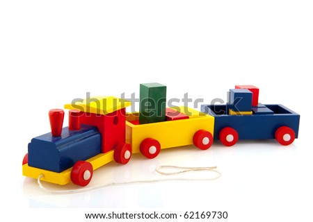 Wooden toy train with colorful blocks locomotive and wagons - stock photo