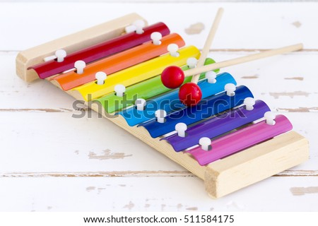Wooden toy xylophone in rainbow colors. Educational toy for kids and toddlers