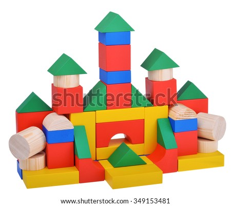 Wooden toys cube castle building game isolated on white background with clipping path - stock photo