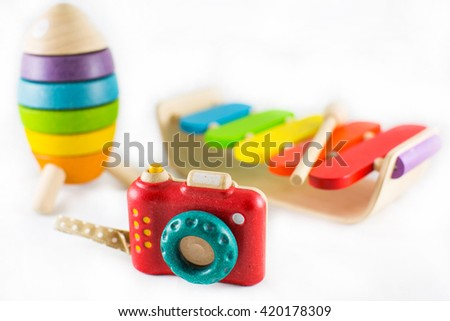 Wooden toys isolated on white background. Selected focus at camera. - stock photo
