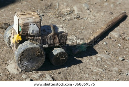 Wooden tractor handmade, so the children play in Mongolia - stock photo